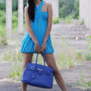 Mary C shows off her gorgeous tanned body as she strips her blue dress.