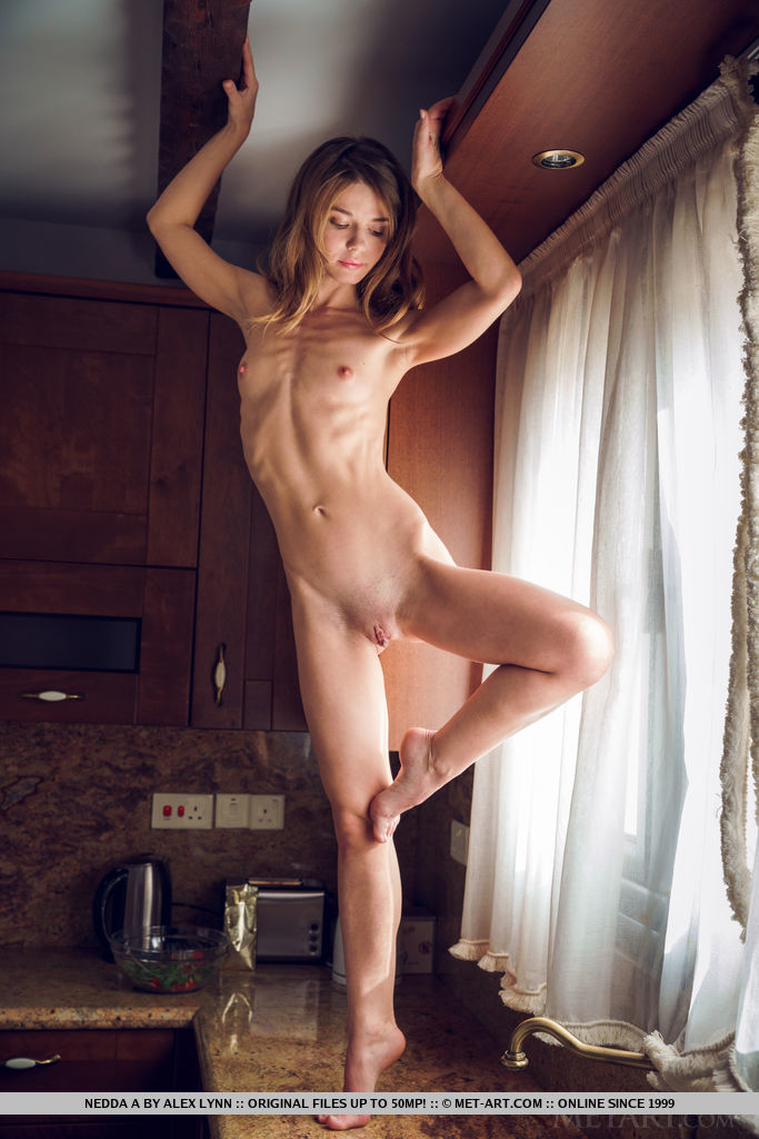 Nedda A prepares her breakfast as she displays her yummy body in the kitchen.