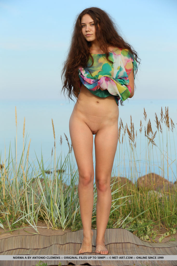 Norma A flaunts her slim body outdoors