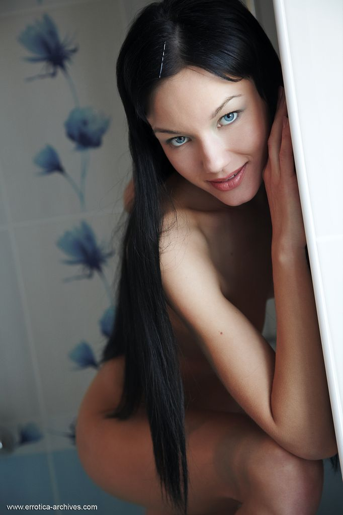 Oh so playful Loreen poses in a white bathroom with blue flowers behind her and displays one of the loveliest little pussies you will ever see.