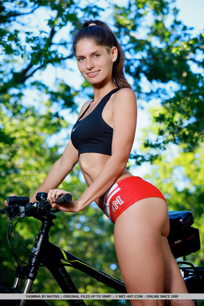 Yasmina amazing physique as she rides her bike outdoors.