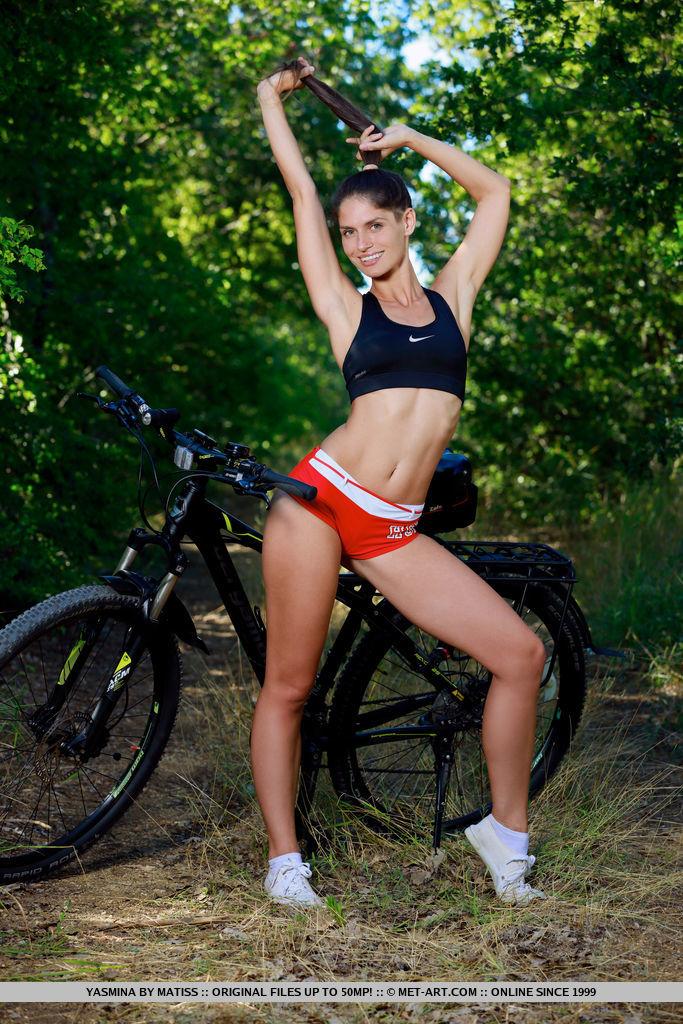 Yasmina amazing physique as she rides her bike outdoors.