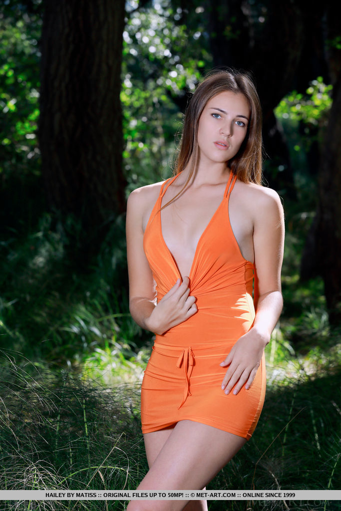 Hailey strips her favorite orange dress as she bares her sexy, slender body in the forest.
