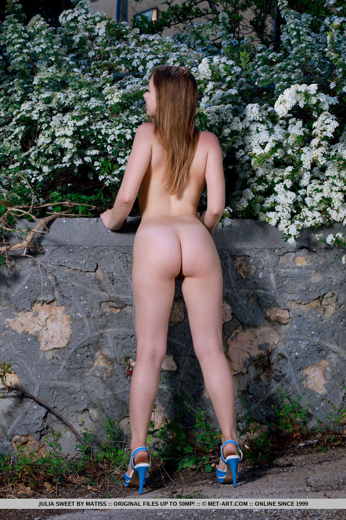 Julia Sweet bares her gorgeous ass and meaty pussy as she strips in the garden.