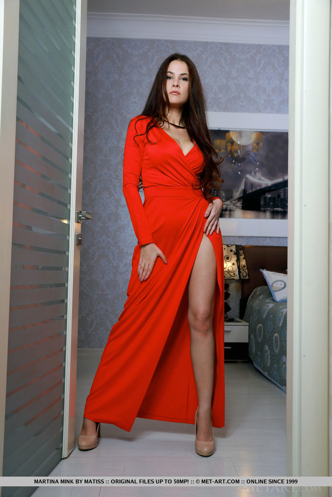 Martina Mink shows off her amazing body  as she strips her sexy, red dress on the bed.