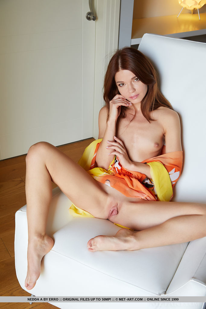 Nedda A spreads her sexy legs wide open, baring her sweet, pink pussy of the white chair.