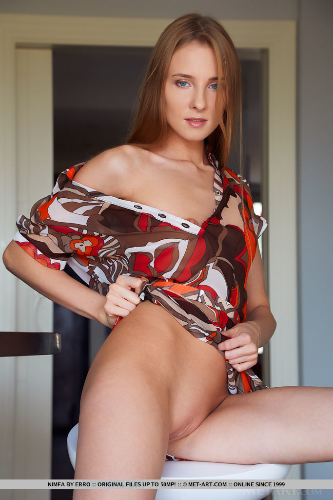 Nimfa shows off her petite body and small pussy as she strips in the kitchen.