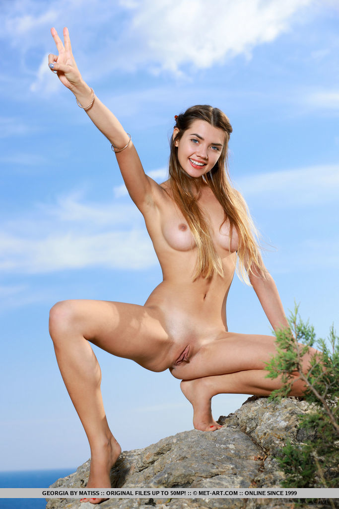 Top model Georgia strips outdoors as she bares her sexy, slender body.