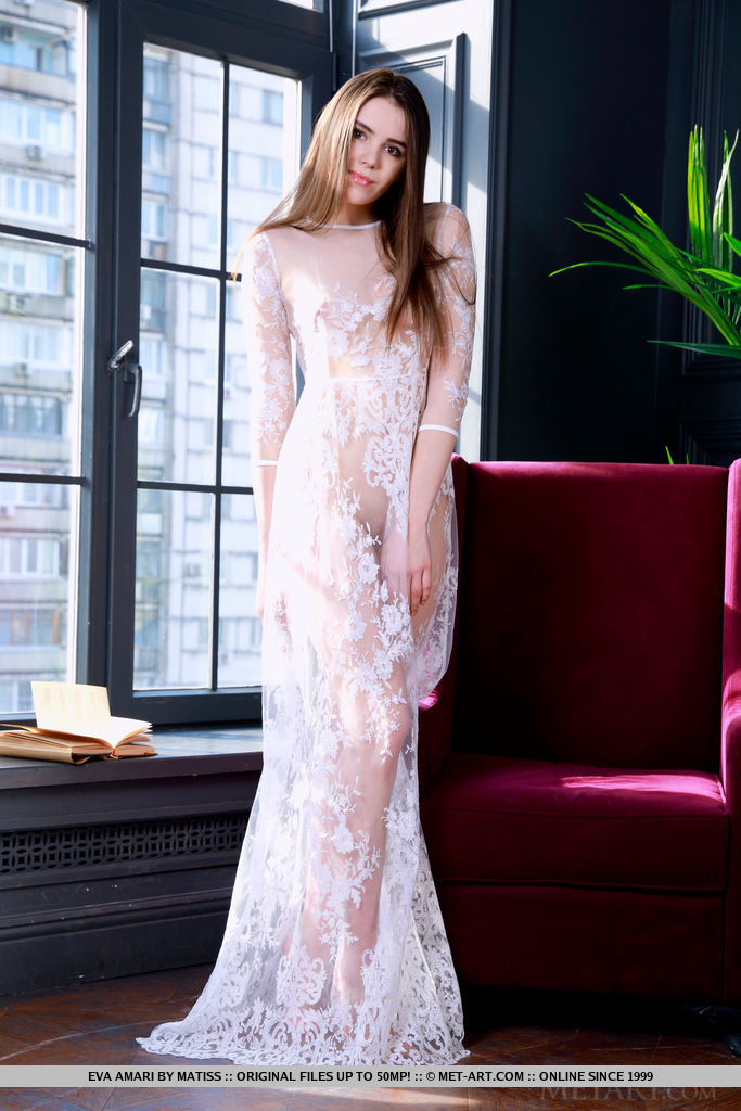 Eva Amari strips her sexy, white gown as she displays her amazing body.