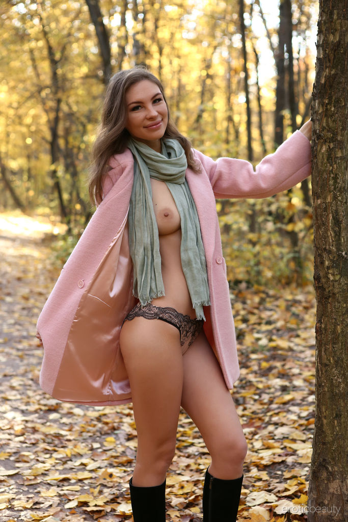 Galina A bares her sexy, slender body and curvy hips as she poses in the park.