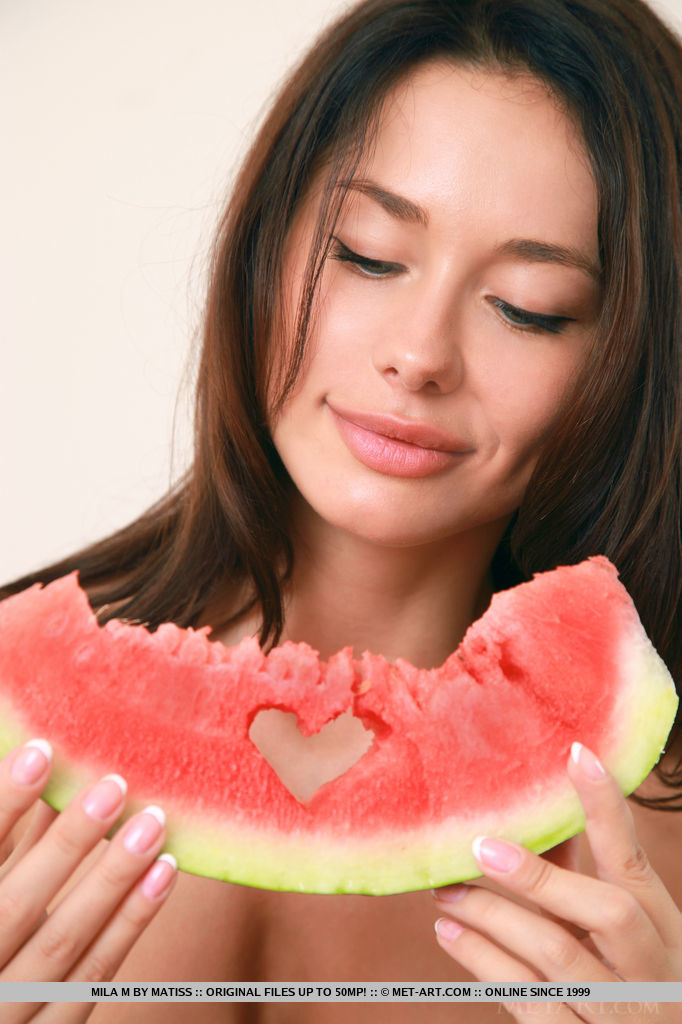 Mila M gets naughty and naked while eating a watermelon