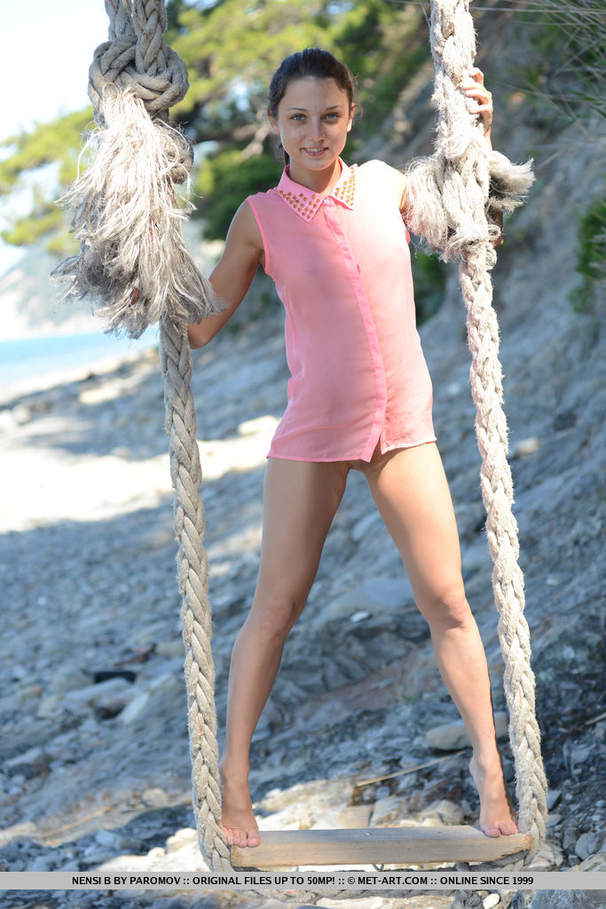 Nubile cutie Nensi B takes off her pink top plays naked on a swing