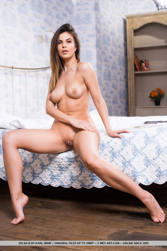 Zelda B strips her laced body suit, baring her mouth-watering body on the bed.