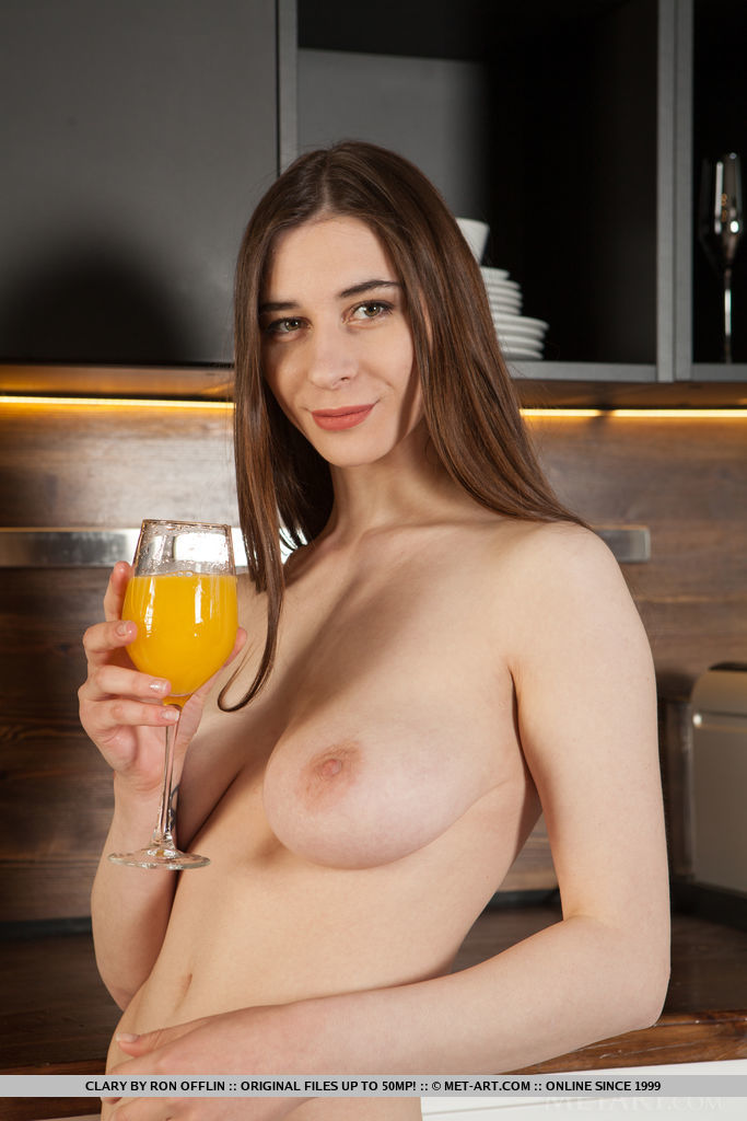 Clary shows off her gorgeous titties and meaty pussy as she poses in the kitchen.