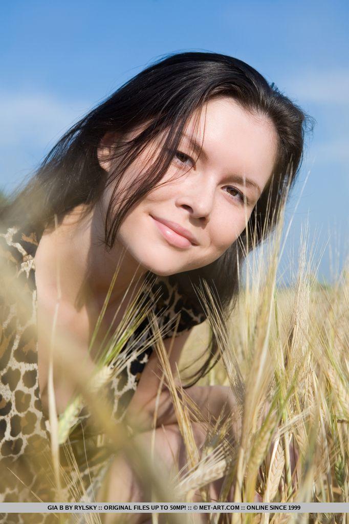 Gia B stroles through a field nude
