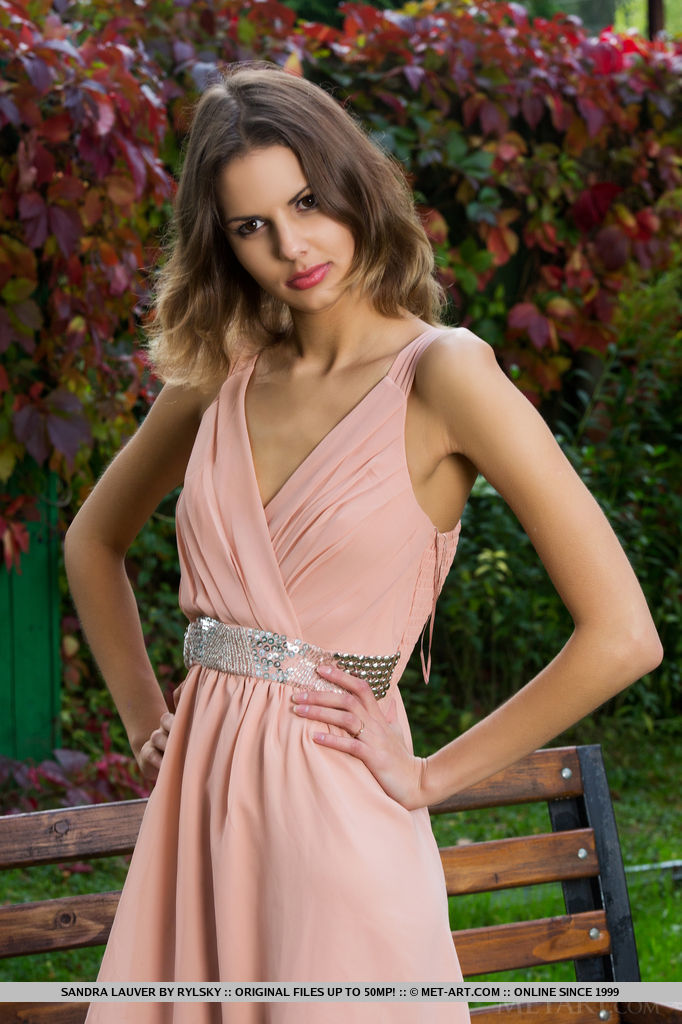 Sandra Lauver slowly works her way out of her pretty dress to play around naked on a park bench