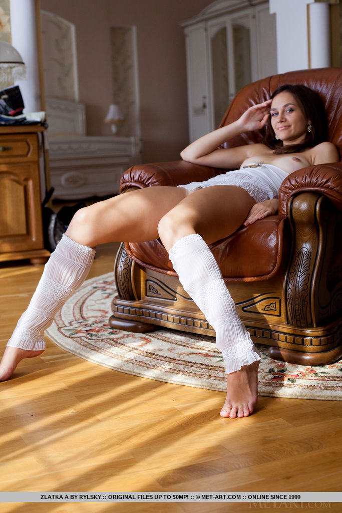 Zlatka A showcases her svelte legs wearing white leg warmers and her body is flexible poses