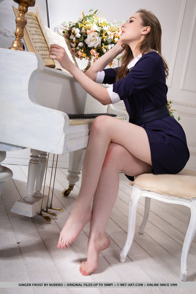Ginger Frost looks elegant in her dress. She turns into a sexy babe, naked by the piano.