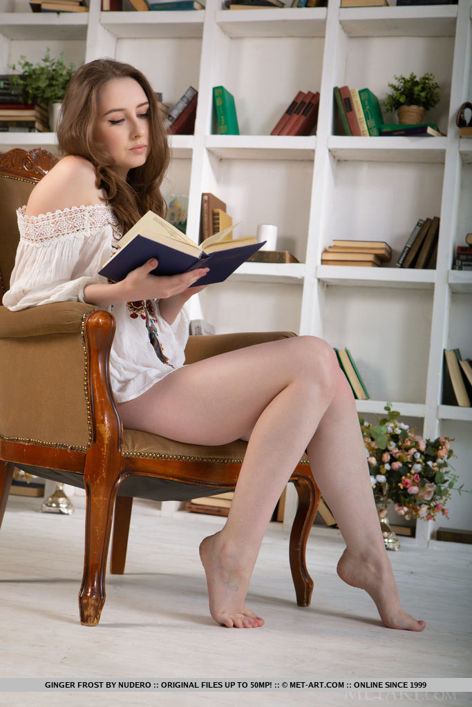 Ginger Frost reads her favorite book as she undress her white tassled dress on the chair.