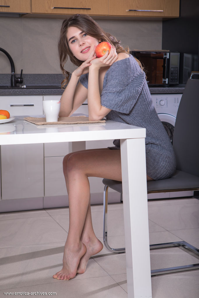 Luna Pica strips in the kitchen, baring her sexy, slender body as she eats her apple.