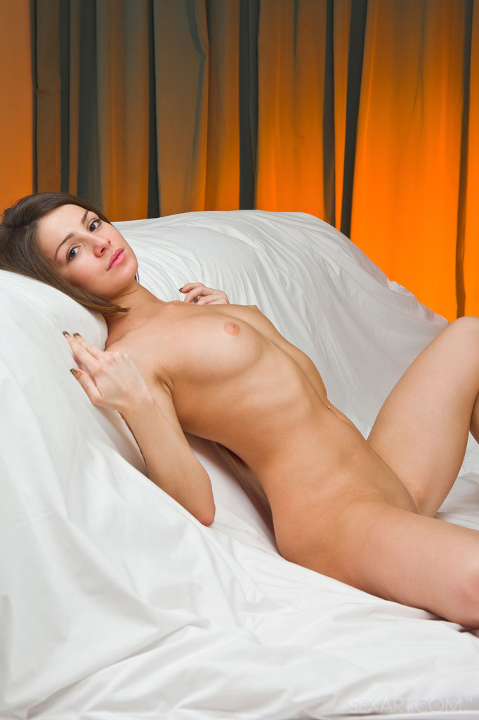 Cute and horny Susana C satisfies her pink and moist pussy with a glass dildo.