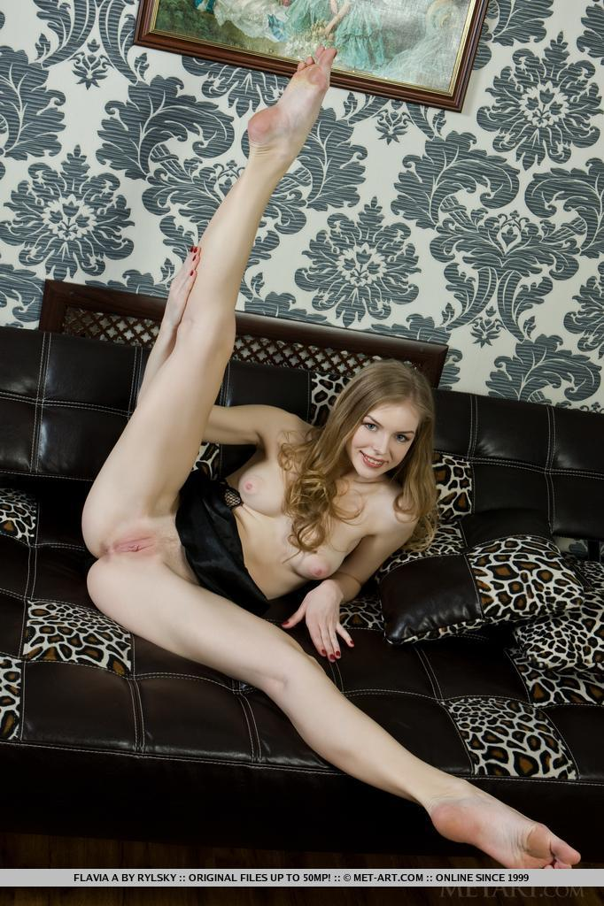 Flavia A is a gorgeous blonde wearing a little black satin gown showing off her long sexy legs