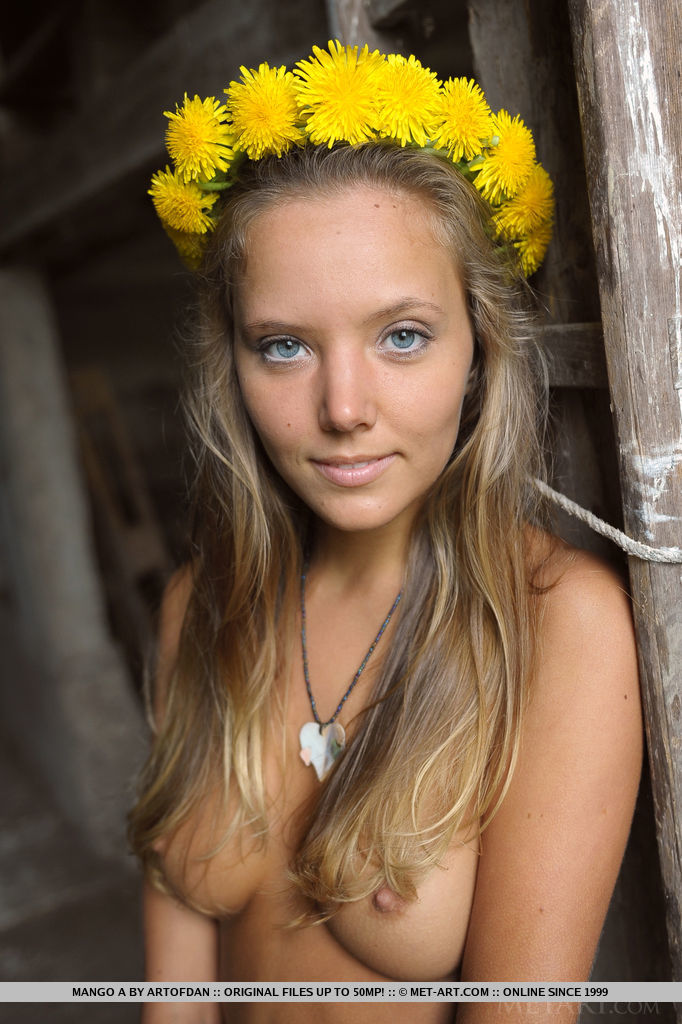 Mango A looks luscious naked on a wagon wearing a crown of yellow flowers in her hair