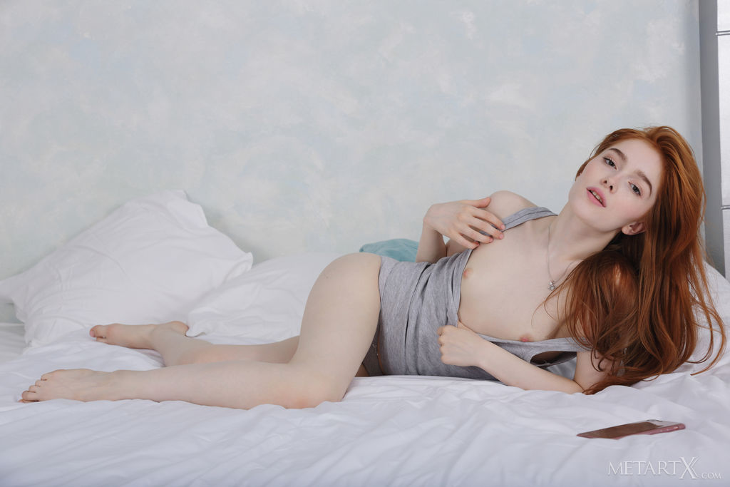 Redhead Jia Lissa takes selfies on the bed. She takes off her clothes and fingers herself.