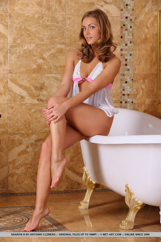 Stunning Sharon D strips naked and plays in the bath tub.