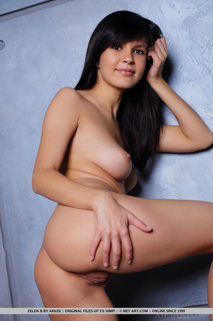 Zelda B strips out of her vest and skirt to reveal her perfectly shaved holes.