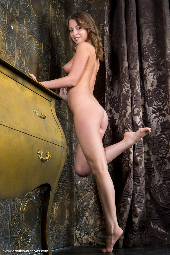 Nikia A looks elegant as she poses nude indoors. She poses her flexible body in different angles.