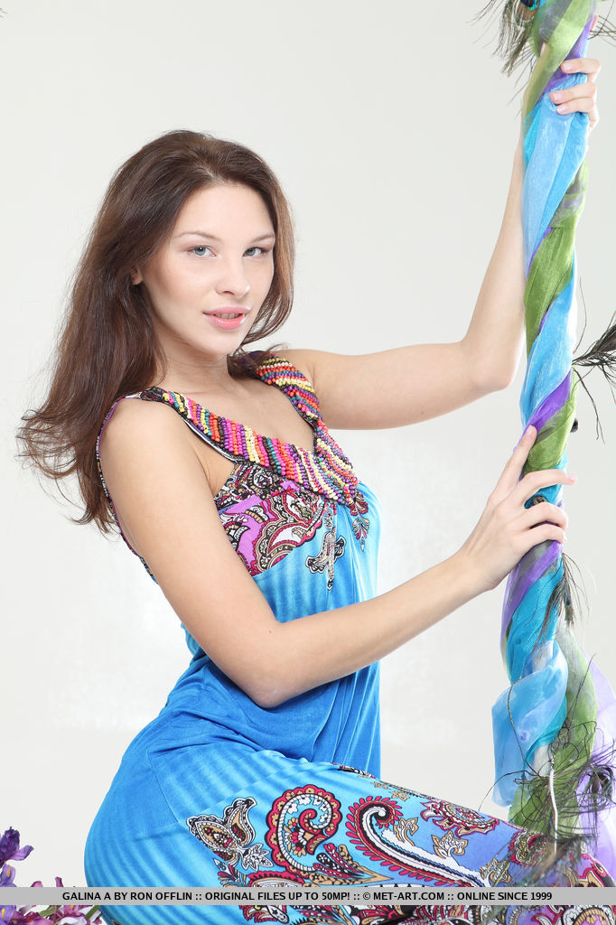 With a pretty smile and dazzling blue eyes, Galina A flaunts her elegantly smooth body with scrumptious puffy breasts and velvetly legs.