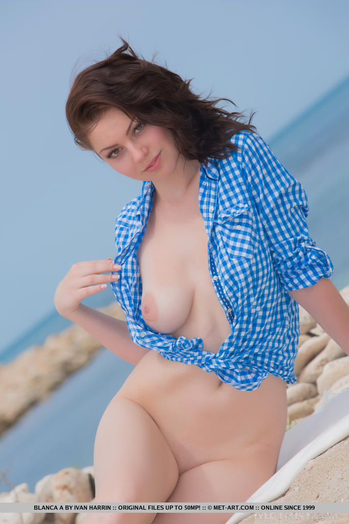 Beautiful Blanca A posing on the beach in her blue and white checkered blouse