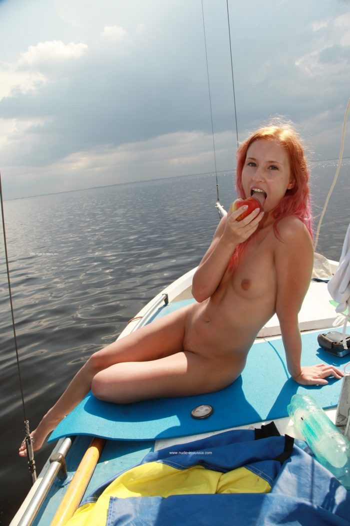 Beautiful redhead Margarita S eats apple on yacht