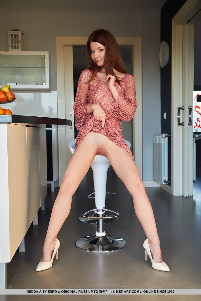 Brown-haired Nedda A looks stunning in her mesh dress in the kitchen. She then poses naked on the bar stool and kitchen counter.