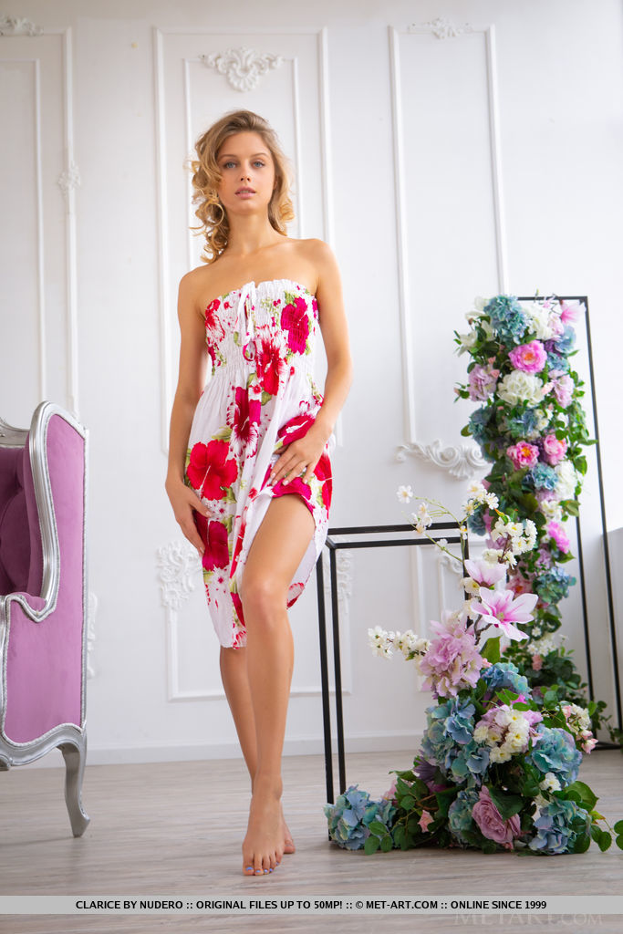 Clarice takes off her floral tube dress and poses her gorgeous body on the couch.