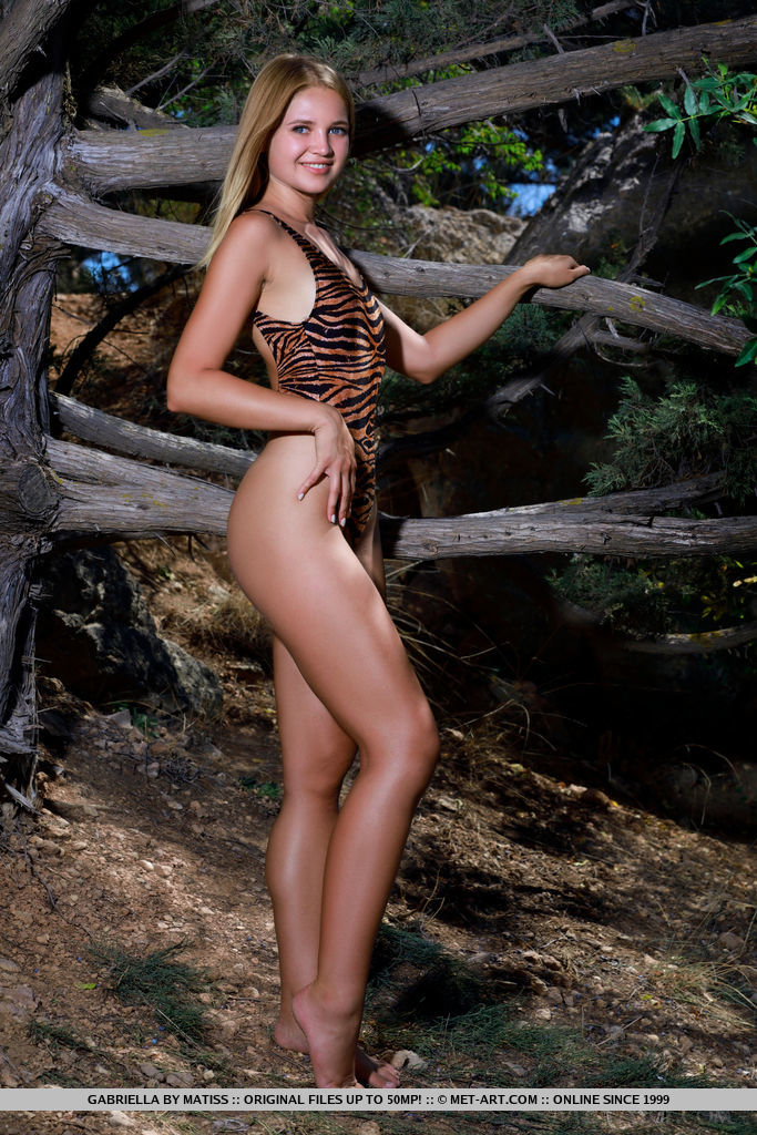 Gabriella looks amazing in her tiger print one piece. She goes nude and shows off her amazingly toned body.
