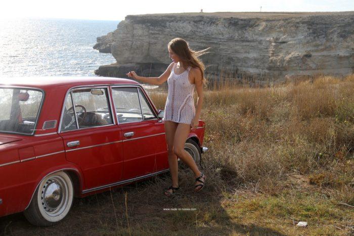 Lovely teen Valentina K near old car