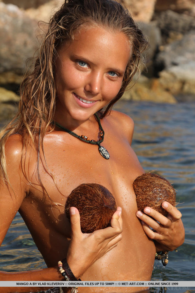 Mango A playing at the beach covering her lovely lickable breasts with coconut shells