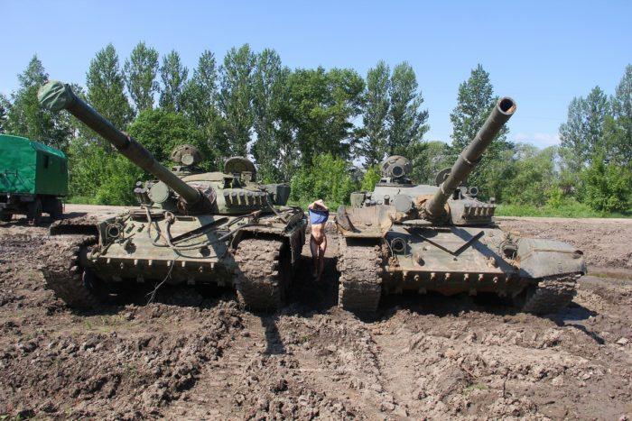 Naked Diana A posing on tanks