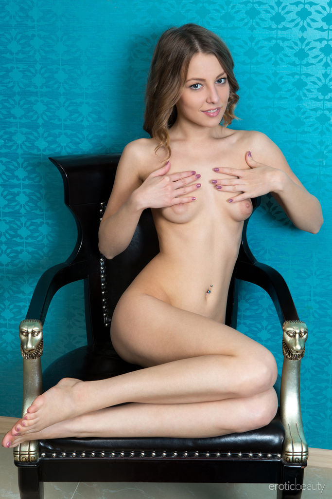 Nikia A is fully nude in the bedroom. Her poses beautifully show off her manicured pussy.