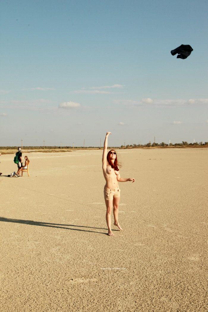 Redheaded teen Renara at dried lake