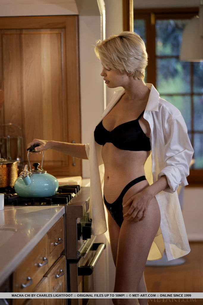 Short-haired beauty Macha Chi sips her hot drink in the kitchen while taking off her black bra and panties.
