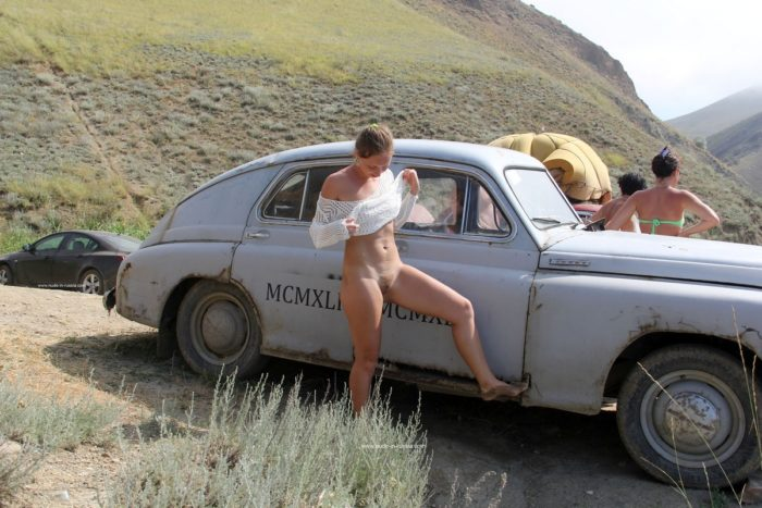 Margarita S with unshaved pussy near very old car
