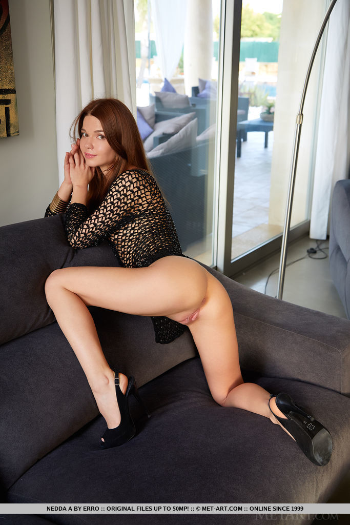 Nedda A flirtatiously show off her sexy legs, bumtastic body and shaved cooch in net-like bodysuit and sexy black high heels.
