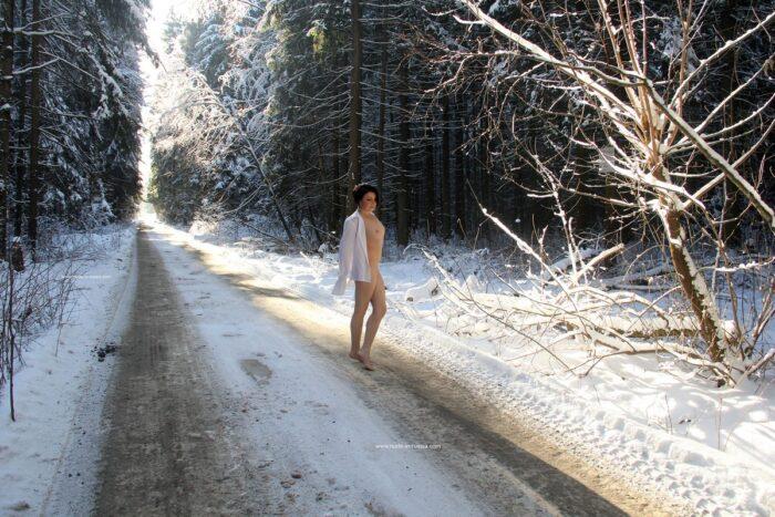 Brunette Klara on snowy road
