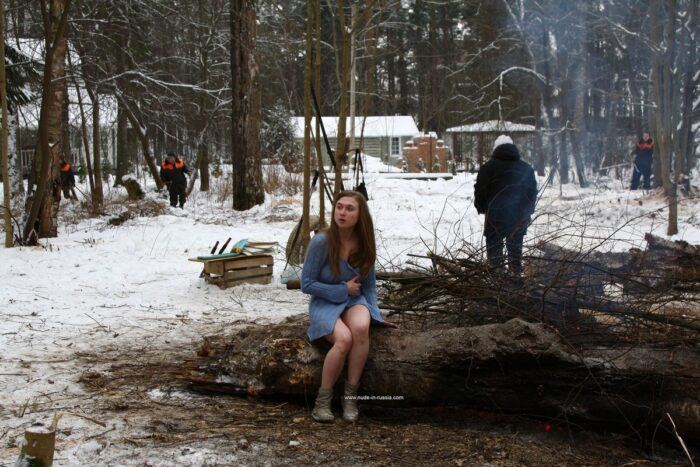 Busty teen Dana flashes her body by the winter fire