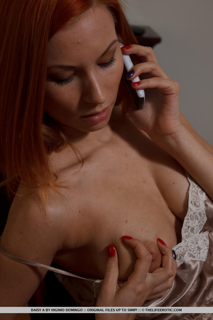 Daisy serves a spicy hot series filled with lots of provocative poses and masturbation while talking on the phone.