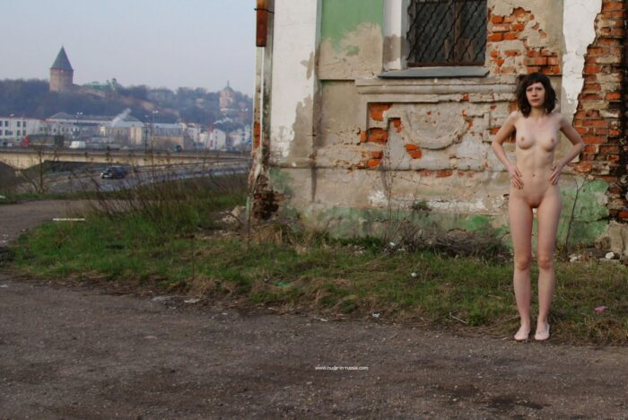 Naked Ekaterina S with sporty body near old church
