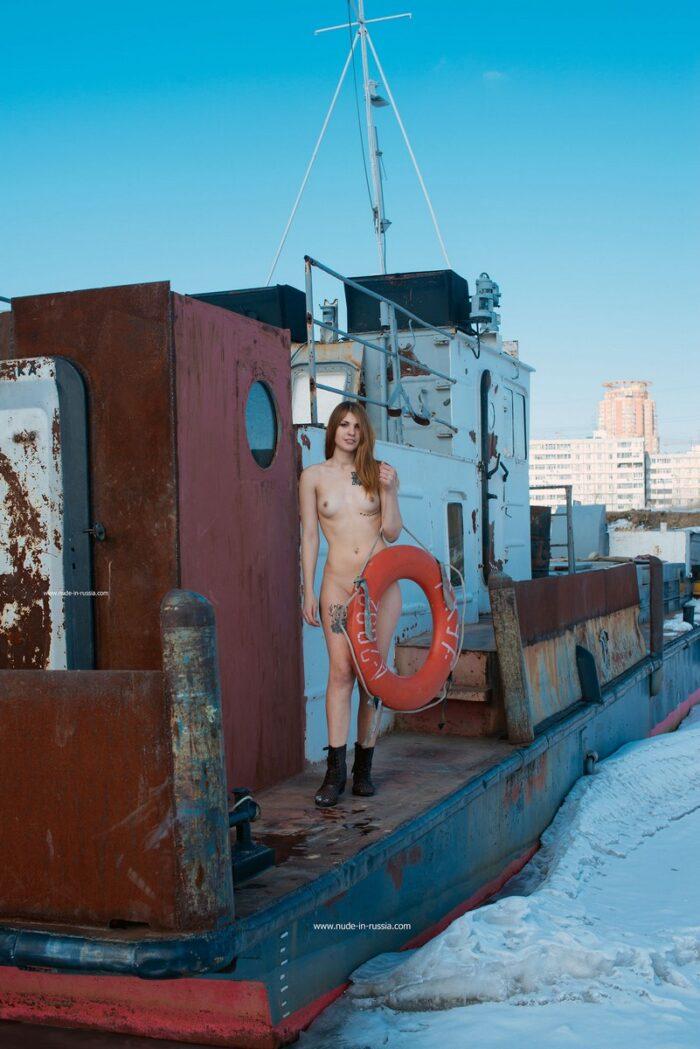 Super sexy tattoed model Anna I on frozen river